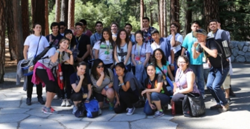 group of students in front of forest